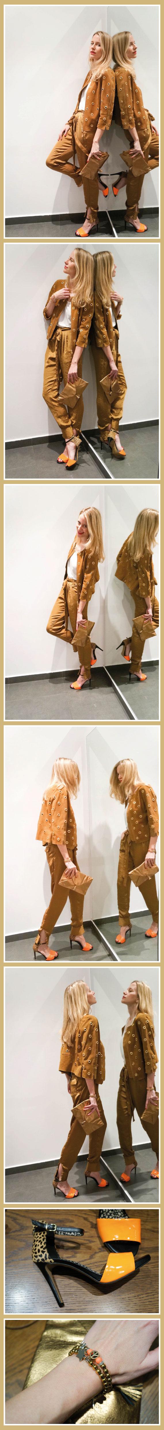 María León con cazadora de ante camel y pantalón de seda de HOSS INTROPIA, sandalia con print animal y naranja flúor de Jessica Simpson y pulseras en dorado con flúor de La Chsipa Adecuada.